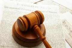 legal gavel with declaration of independence and constitution documents - stock photo
