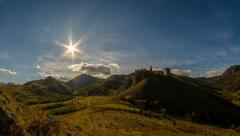 Coltesti fortress in autumn landscape time lapse with sun moving Stock Footage
