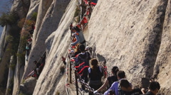 Huashan. People going to Changkong zhandao Stock Footage