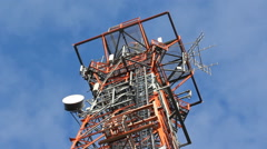 Red and white communication tower. Detail. - stock footage