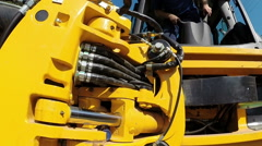 A Worker Operates Heavy Machinery Stock Footage