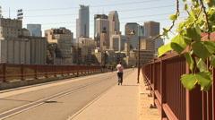 Walking and Biking on Stone Arch Bridge Stock Footage