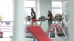 Gym girls on running track treadmill Stock Footage
