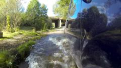 Crossing stream on a car. Stock Footage