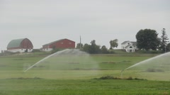 Irrigating farmers crops Stock Footage