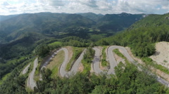 Aerial wide shot of whole serpentine downhill road track Stock Footage