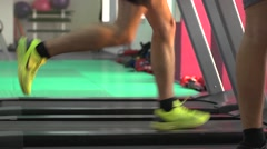Men's Sports legs on a treadmill in gym Stock Footage