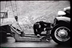 Vintage B&W footage of a tow truck in action Stock Footage