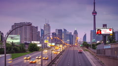 Highway traffic with Toronto skyline in time-lapse Stock Footage