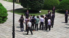 Stock Video Footage of News Media Reporters Digniaties Politians Gather At Chungnyeolsa Shrine Busan 4K