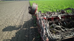 Closeup harvester working on beet field Stock Footage
