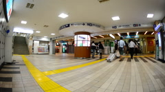Time Lapse of Passengers at Busy Mono Rail Station Lobby in Tokyo Japan Stock Footage
