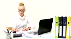 Beautiful businesswoman using laptop and a phone Stock Footage