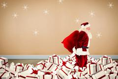 Composite image of santa walking on pile of gifts Stock Illustration