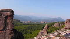 Women feet in sport shoes step on a rock, tourist admire the Belogradchik valley Stock Footage