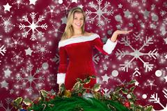 Stock Illustration of Composite image of pretty girl presenting in santa outfit