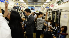 Time Lapse of Train Passengers Riding a Busy Subway Car - Tokyo Metro Rail Stock Footage