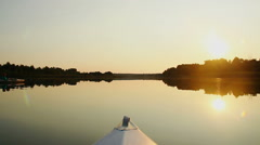 Peaceful view of beautiful sunset on river, riding a boat Stock Footage