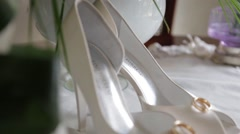 Wedding shoes with wedding ring - stock footage