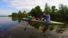 Stock Video Footage of Young man and woman paddling boat, active rest, slowmotion