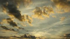 Time lapse sunrise  yellow fluffy clouds over sky Stock Footage