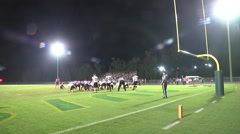 Extra point kick good night game wide angle Stock Footage
