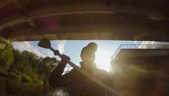 Young man tourist paddling boat under bridge, fishing, slow-mo Stock Footage