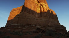 Wide panning shot of tall rock formation in national park / Arches National - stock footage