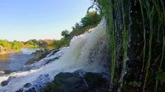 Turbulent waterfall splashing against rocks, river, wild nature Stock Footage