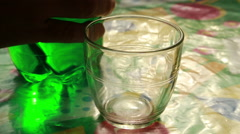 Sparkling green soft drink poured into a glass Stock Footage