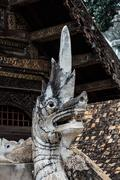 old naga statue in thai temple - stock photo