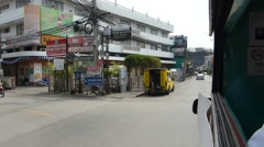 Travelling in a songthaew on a busy road in Chiang Mai, Thailand. Stock Footage