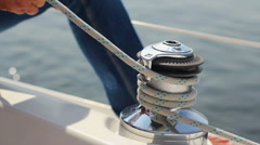 Sailor quickly untying sail rope on yacht. Preparing to sail, click for HD Stock Footage