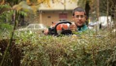 15. Gardener trimming hedge.Worker shaping bushy fence.Electric trimmer.Cutting. Stock Footage