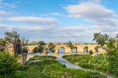 ancient water mill and roman bridge - stock photo
