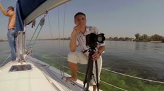 Male tourists on yacht, cruising, vacation, traveling, sailing, click for HD Stock Footage