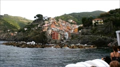 Riomaggiore, Cinque Terre, Italy seen from ferry Stock Footage