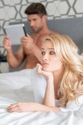 Macro Pretty Couple Partner on Bed Fashion Shoot Stock Photos