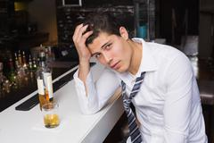 Stock Photo of Young man after drinking too much