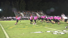 Running back dashes off tackle for a first down Stock Footage
