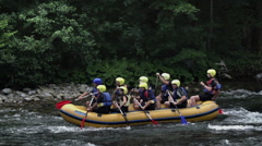 Rafting team on adrenalin journey Stock Footage