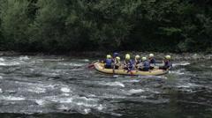 Rafting team avoid rocks Stock Footage