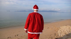 Santa Claus Relaxing on the Beach. Christmas or Happy New Year. Stock Footage