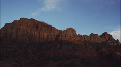 Wide time lapse shot of sun passing over mountain / Zions National Park, Utah, Stock Footage