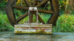 Old mill water wheel on river. Turning from power of a water stream. Stock Footage