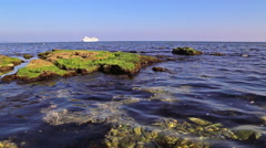 Rocky beach and passenger ship - stock footage