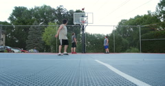 Young boys playing basketball . 4K Stock Footage