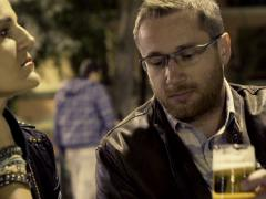 Bored couple sitting in outdoor bar at night NTSC Stock Footage