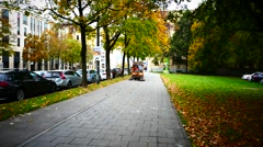 Sweeper Truck cleaning Autumn leaves on pavement Stock Footage