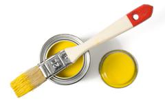 paintbrush on top of varnish can - stock photo